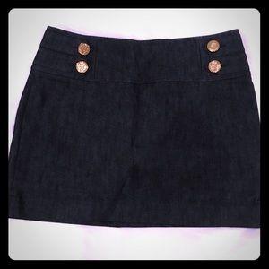 Dark denim mini skirt with sailor button detail.